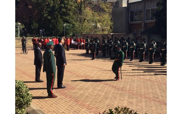 Ambassador Christophe Farnaud reviewing the Lesotho troops